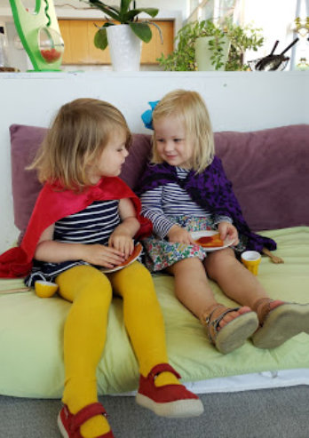 children sitting on the couch and playing