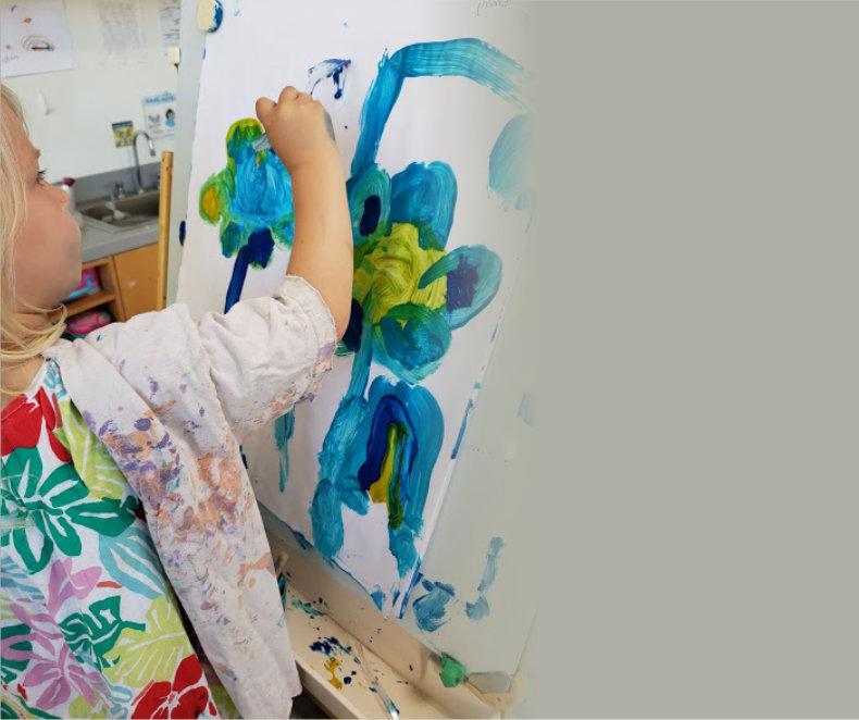 child having an amazing painting