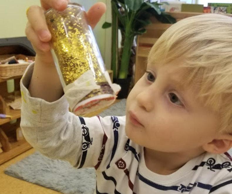 boy holding a bottle of glitters