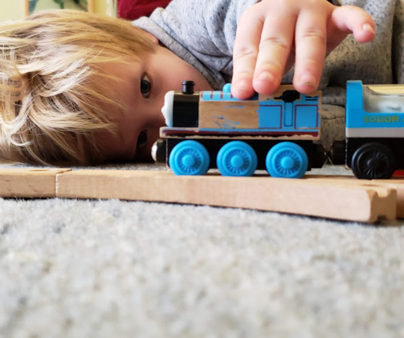 boy playing a toy train